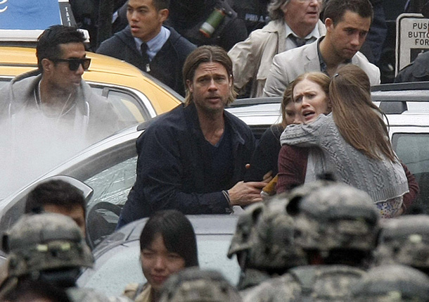 Brad Pitt and Mireille Enos in World War Z.