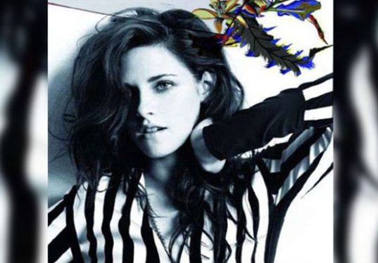 Kristen Stewart strikes a pose in the lastest Balenciaga's perfume Florabotanica ad, which appears in the latest issue of Spanish Elle magazine.