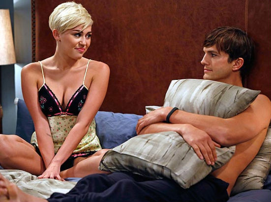 Miley Cyrus and Ashton Kutcher in Two and a Half Men. (GREG GAYNE/WARNER BROS)