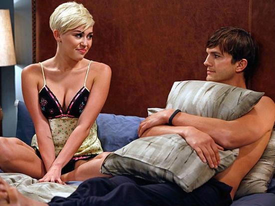 Miley Cyrus and Ashton Kutcher in Two and a Half Men. (GREG GAYNE/WARNER BROS)